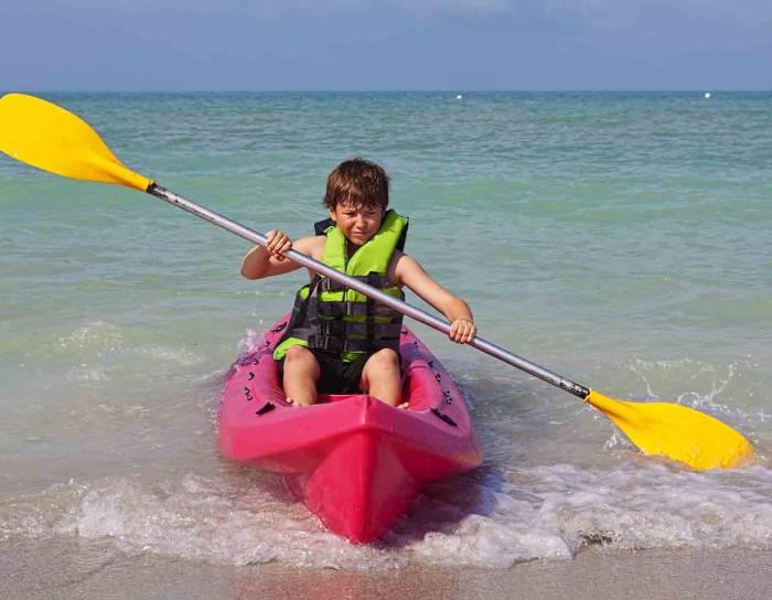 little boy in a kayak
