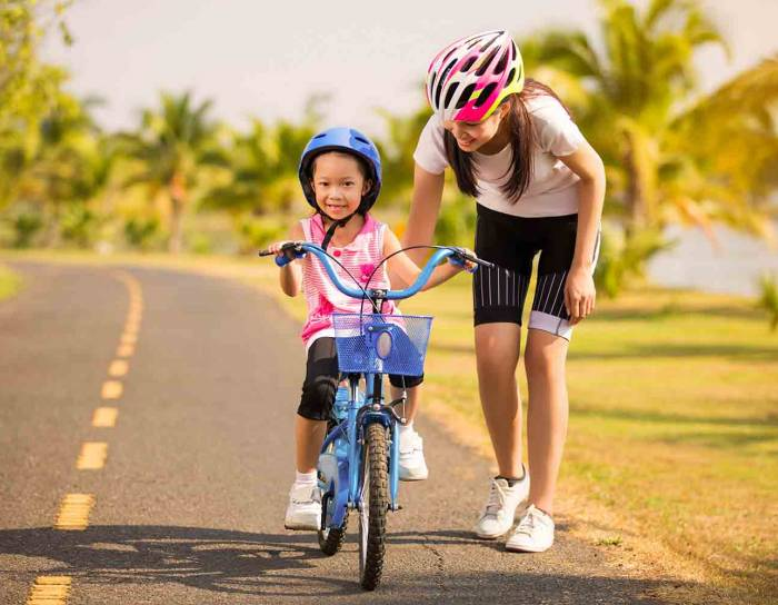 Child learning how to ride a bicycle