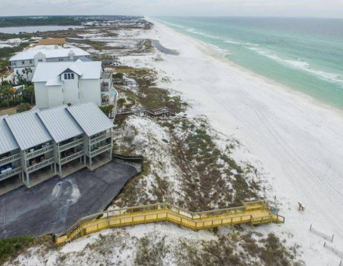 Ariel view of the beach and a home at Seagrove Beach