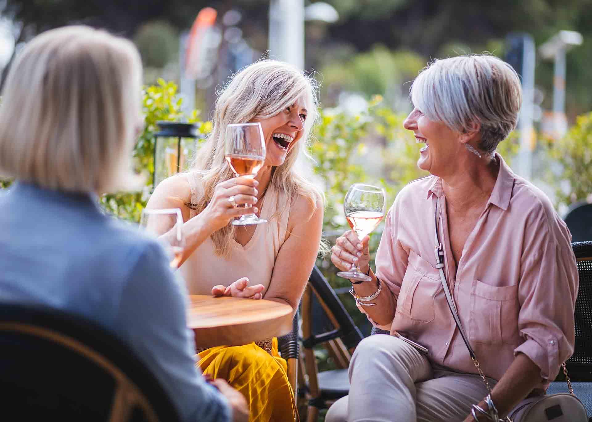 Friends enjoying wine together in Florida